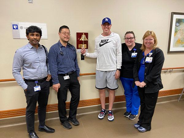 Matt Cross with various hospital staff